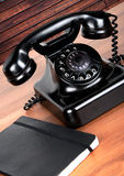 Old vintage phone. On antique writing desk Royalty Free Stock Photos