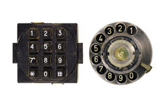 Old vintage phone dial and button keypad isolated on white Stock Images