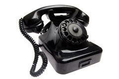 Old vintage phone isolated. Old black vintage phone isolated stock photos