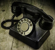 Old vintage phone with rotary disc on wooden table grunge backgr Royalty Free Stock Photo