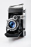 Old vintage photo camera. Isolated on white background Stock Photos