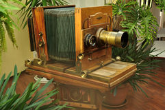 Old vintage photo camera in the interior of museum-photosalon of Karl Bulla on Nevsky Prospect in Saint-Petersburg, Russia Royalty Free Stock Image