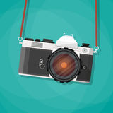 Old vintage photo camera with strap. Royalty Free Stock Photos