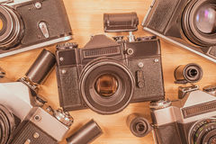 Old vintage photo-cameras and tape cassettes. Stock Photography