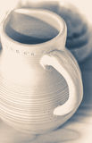 Old vintage photo. Jug of clay. Pitcher made of white clay. Royalty Free Stock Image