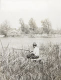 Old vintage photo man with a fishing rod Stock Photo