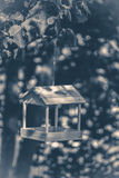 Old vintage photo. Wooden feeder in the woods Royalty Free Stock Photography