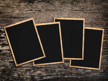 Old vintage  photos on a wooden background Stock Photography