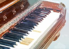 Old vintage piano with a few missing keys Royalty Free Stock Images