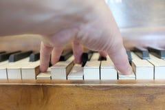 Old Vintage Piano Keys Ebony Ivory Black White. Old vintage piano with ebony and ivory keys black and white playing music Royalty Free Stock Photos