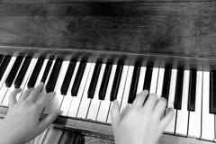 Old Vintage Piano Keys Ebony Ivory Black White. Old vintage piano with ebony and ivory keys black and white playing music Stock Photography