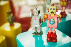 Old vintage pink robot toy on a color blurry background. stock image
