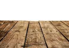 Old vintage planked wood table in perspective on white stock images