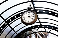 Old vintage pocket watch hanging from canopy royalty free stock photos