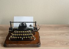 Ancient vintage portable typewriter with non qwerty keyboard. Old vintage portable typewriter with non qwerty type keys on wooden desk stock photos
