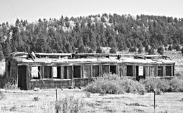Old Vintage Pullman Railroad Car Abandoned Black and White Train. An old and abandoned Pullman railroad car of yesteryear lies in disrepair in a mountain field Stock Images
