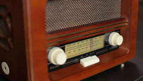 Old vintage radio with brown wooden background. stock footage