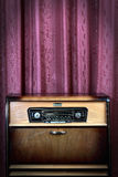 Old vintage radio on red background Royalty Free Stock Images