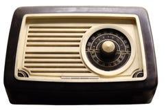 Old vintage radio on white. Dusty vintage radio isolated on white Royalty Free Stock Photos