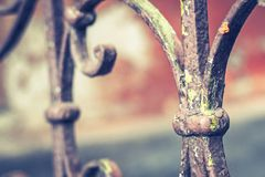 Old vintage railing with rust on the stairs in the house. Forged railing steps in the house stock image