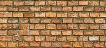 Old vintage red brick wall fragment background texture. Close up Stock Photos