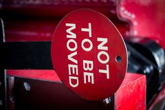 Old vintage red Not To Be Moved sign royalty free stock photos