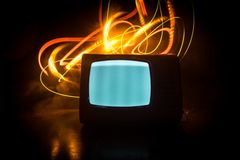 Old vintage red TV with white noise on dark toned foggy background. Retro old Television reciever no signal. Selective focus stock image