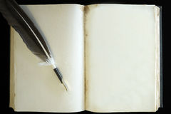 Old vintage retro book blank page and feather pen royalty free stock images