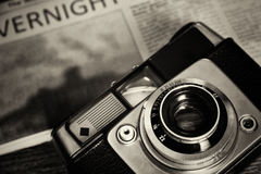 Old vintage retro camera with mocked up newspaper Royalty Free Stock Photos