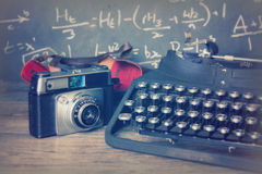 Old vintage retro camera with old-fashioned typewriter Royalty Free Stock Images