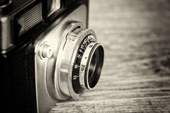 Old vintage retro camera on wooden background Royalty Free Stock Images