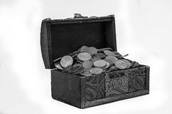 Old vintage retro chest with euro coins isolated on white background Royalty Free Stock Images