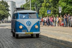 LVIV, UKRAINE - JUNE 2018: Old vintage retro classic blue and white Volkswagen camper bus car rides through the streets of the cit. Old vintage retro classic stock photography