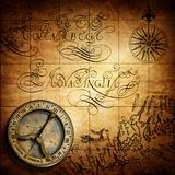 Old vintage retro compass on ancient map background. Royalty Free Stock Images