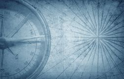 Old vintage retro compass on ancient map. Survival, exploration. And nautical theme grunge background royalty free stock image