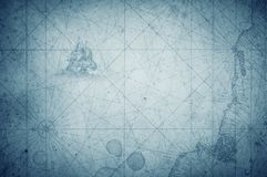 Old vintage retro compass on ancient map. Survival, exploration. And nautical theme grunge blue background royalty free stock images