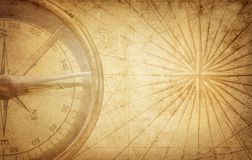 Old vintage retro compass on ancient map. Survival, exploration. And nautical theme grunge background stock photo