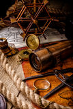 Old vintage retro compass and spyglass on ancient world map stock photography