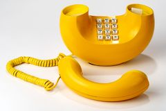 Old Retro Telephone, Yellow, push button dialer. Old Vintage retro corded telephone European style 50s, 60s stock photography