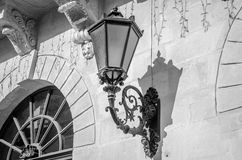 Old vintage retro lamp black classic look on the wall of a house on one of the streets of Lviv Royalty Free Stock Photo