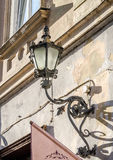 Old vintage retro lamp black classic look on the wall of a house on one of the streets of Lviv Stock Images