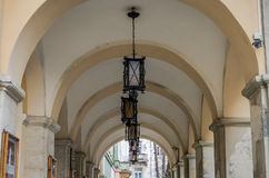 Old vintage retro lamps made of iron and glass for street lighting in the ceiling arches with columns theater Zinkovetskoy Mary in Royalty Free Stock Photo