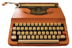 Old vintage Retro orange typewriter. On table Stock Photo