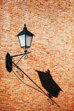 Old vintage retro street lamp on brick wall with copy space back Stock Photography