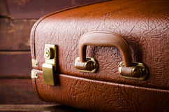 Old vintage, retro suitcase on dark background. Front view Royalty Free Stock Photo
