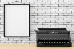 Old Vintage Retro Typewriter in front of Brick Wall with Blank F Royalty Free Stock Photography