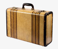 Old vintage rigid frame suitcase. Old vintage classic rigid frame suitcase with brass locks and decorated with stripes standing upright isolated on white Royalty Free Stock Photography