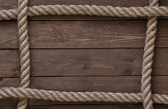 Old vintage rope on old wooden table Stock Photos