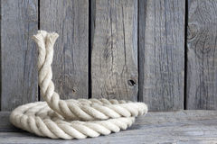 Old vintage rope and planks background Stock Images