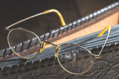 Old vintage round glasses and photo album Stock Image